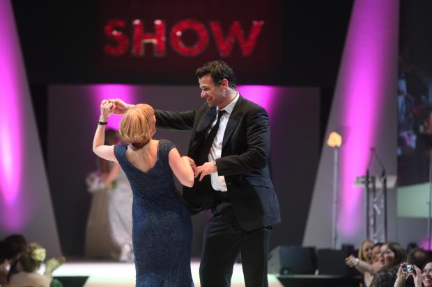 Campaign Series: STAR STRUCK: Anita Hughes being twirled by rugby star Mike Phillips on the catwalk.