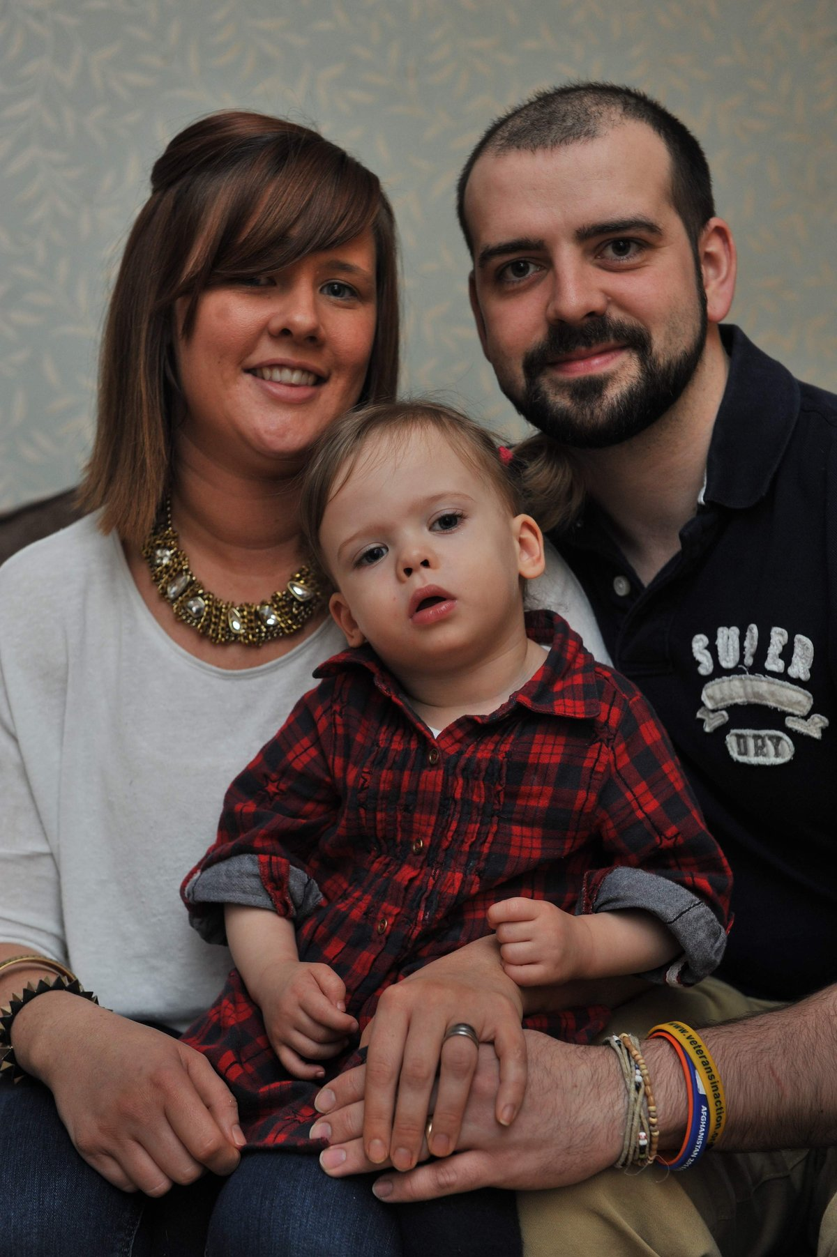 LIFE-CHANGING OP: Maisie Cooper with mum Hayley and dad Gareth