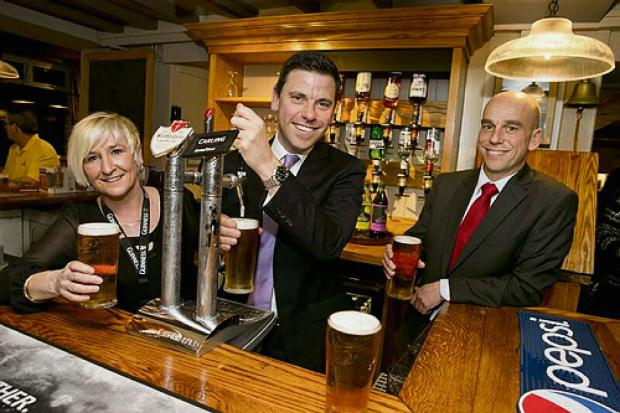 OPENING: Chris Evans, Islwyn MP pulls a pint at the opening of the Mason Arms in Risca
