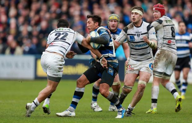 Bath's Gavin Henson is tackled by Brive's Andrew Mailei during the Amlin Challenge Cup Quarter Final match at The Recreation Ground, Bath. PRESS ASSOCIATION Photo. Picture date: Sunday April 6, 2014. See PA story RUGBYU Bath. Photo credit should r