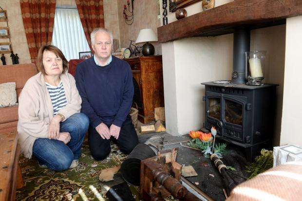 Home of Adrian and Cheyrl Garnham damaged by a lightning strike that hit the chimney of their property in Newbridge. Pictured are Adrian and Cheryl in the living room with the damage caused by the lightning strike. (5745181)