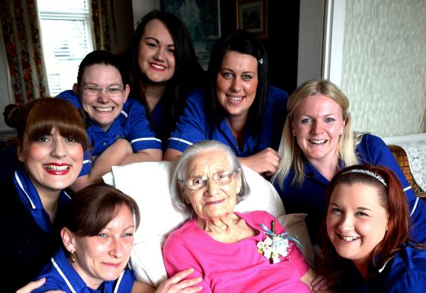 BIRTHDAY  Nancy Evans of Bargoed celebrates being 102 years old.Here she is with carers from left, Kerry Davies, Imrana Saunders, (ok), Louise Williams, Kirstin Bayliss, (ok), Roxanne Stockman, Claire Frowen, (ok), and Rachel Sibley (5678703)