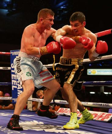 BATTLE: Gary Buckland, left, in action against Stephen Smith last year