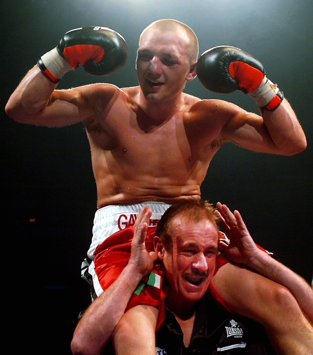 CHAMP: Gavin Rees celebrates his world title win with trainer Enzo Calzaghe in 2007