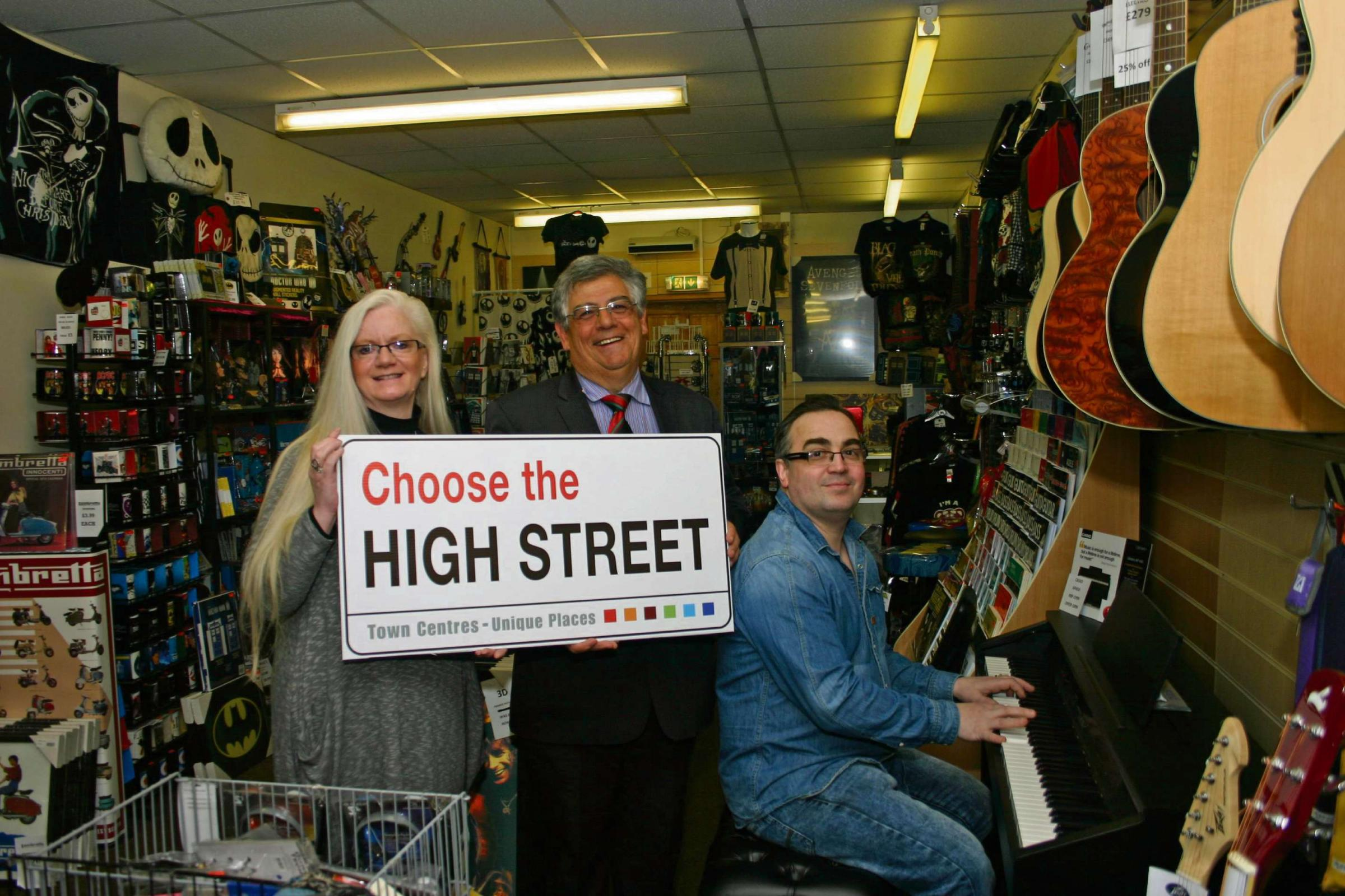 (6325105)CHOOSE THE HIGH STREET: Simon and Trish Fowler, owners of Must Have Music on Blackwood High Street, with councillor Ken James.