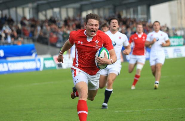 GREAT CAMPAIGN: Wing Ashley Evans crosses the whitewash in Wales Under-20s' Juni