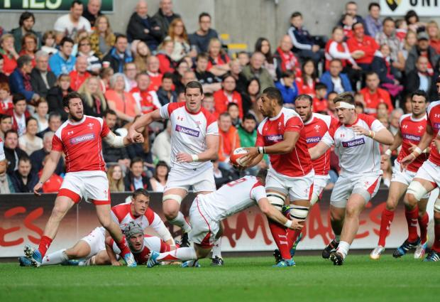 ON THE CHARGE: Dragons No8 Taulupe Faletau attacks for the Wales Probables team (6704903)