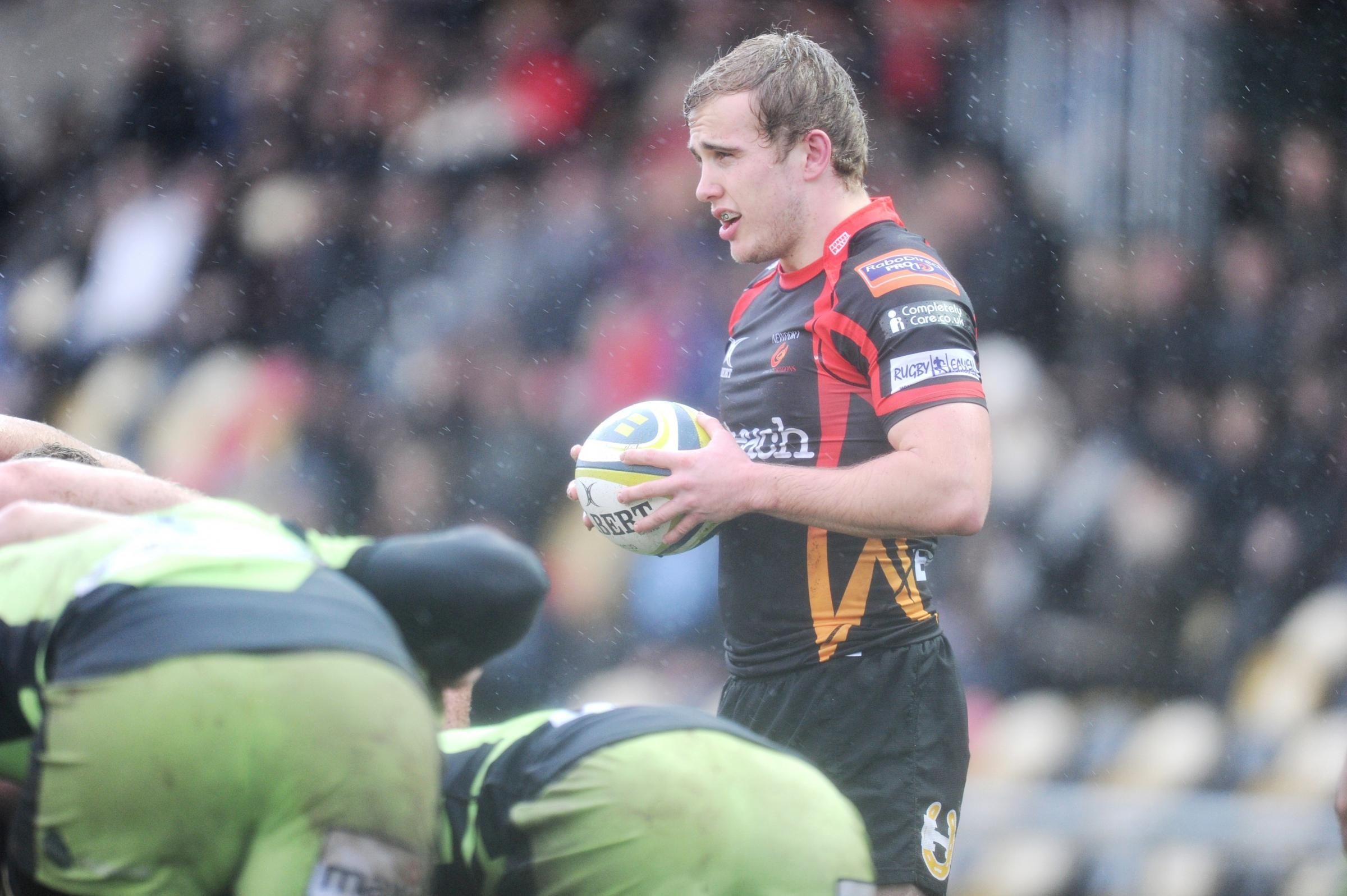 Newport Gwent Dragons v Northampton Saints in LV Cup.  Heavy downpours and hail stones interrupted the first half of the game as Scrum Half Luc Jones prepares to feed the ball to the scrum. (3639416)