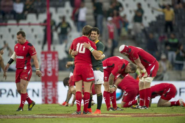 Dan Biggar of Wales, left and Morne Steyn of South Africa middle after South Africa win the match 31 - 30 during their Rugby test match in Nelspruit, South Africa, Saturday, June 21, 2014. (AP Photo). (7386032)