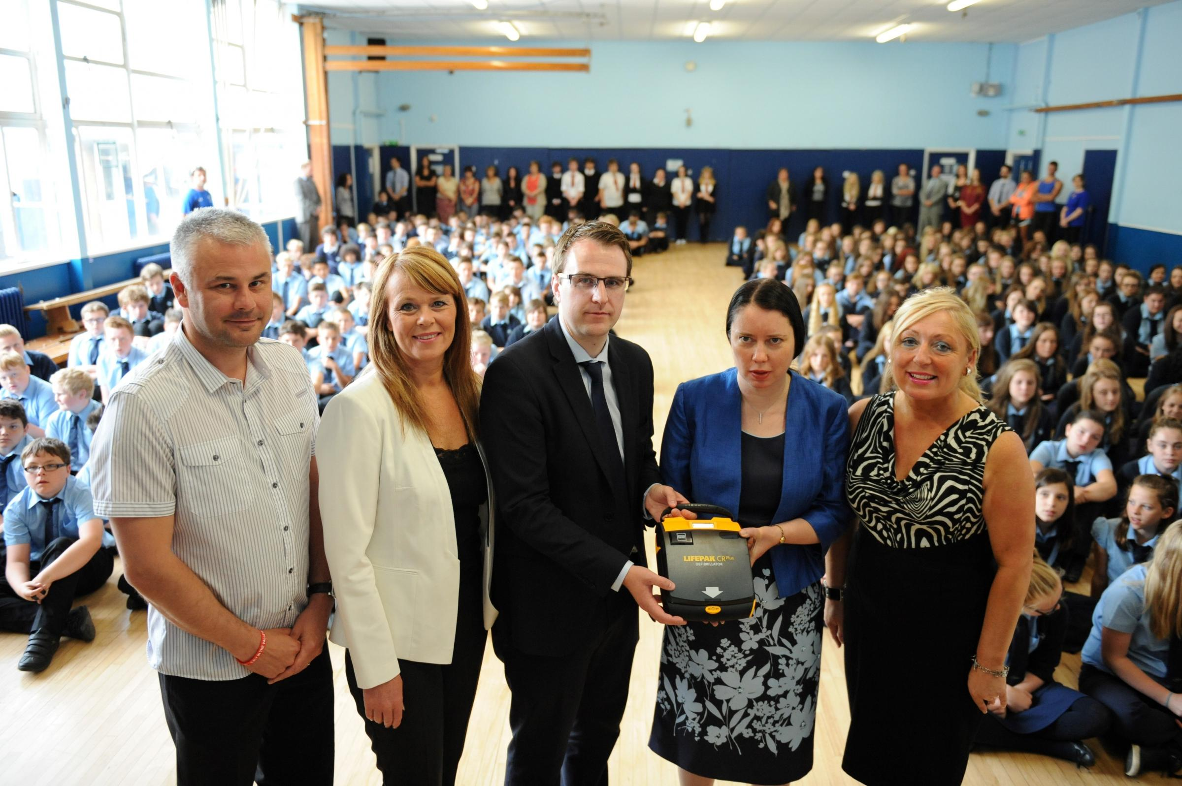 Parents present Cwmcarn school with life-saving device