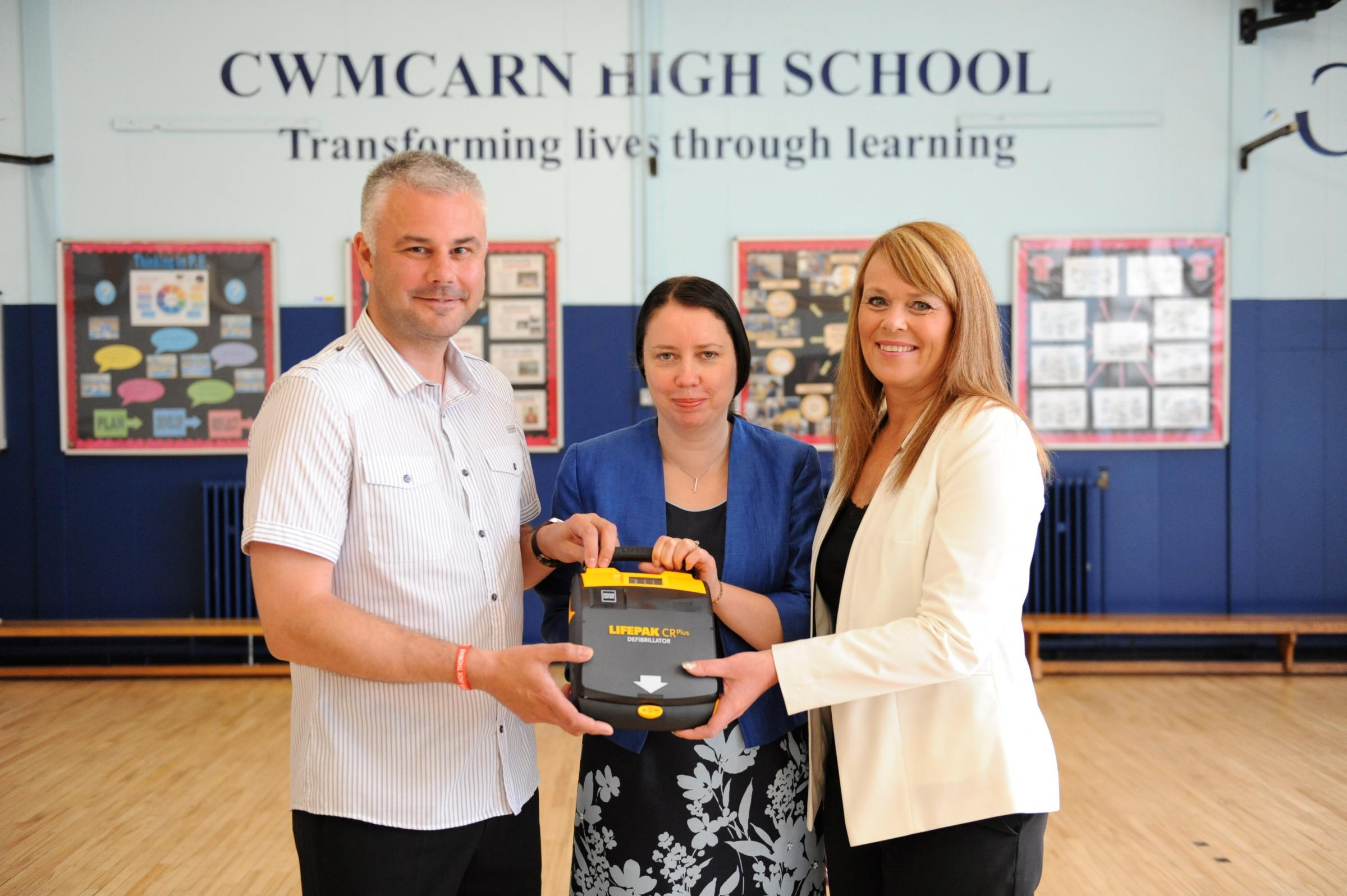 Jack's Appeal with General Dynamics UK presented a heart defibrillator to Cwmcarn High School. Pictured from left Grant Thomas, Jacqui Peplinski Head Teacher and June Thomas.