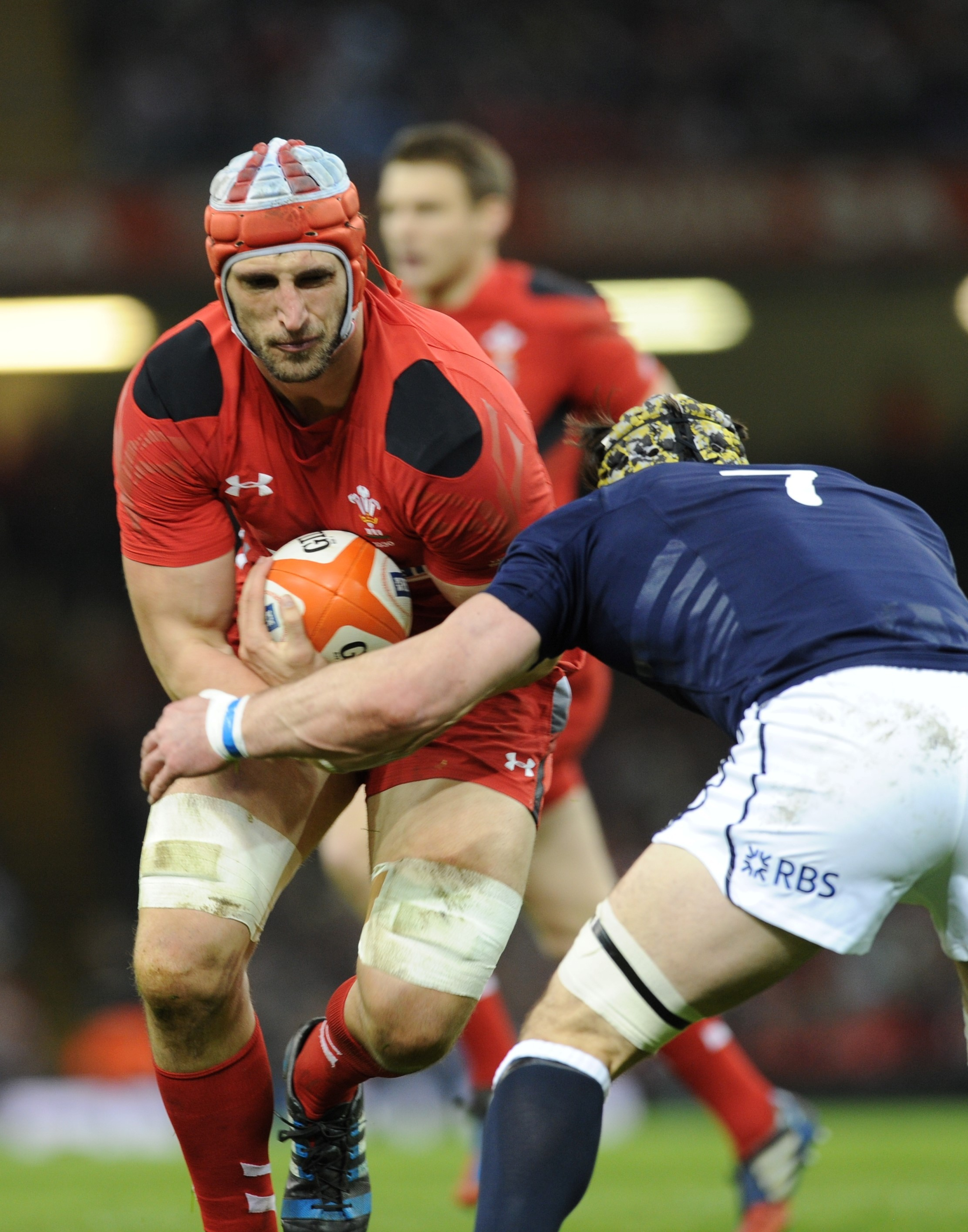 Luke Charteris is tackled by Kelly Brown (4634096)