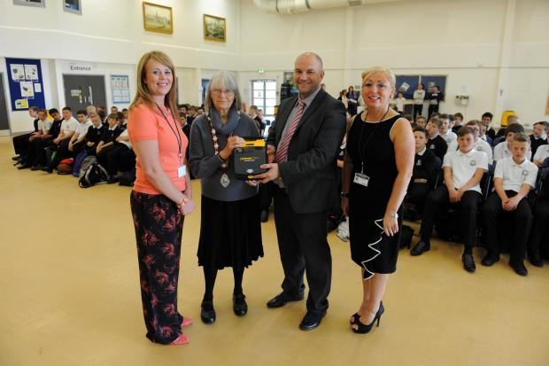 Campaign Series: Lewis School Pengam, Gilfach Bargoed received a heart defibrillator from Gelli Gaer Community Council as part of Jack's Appeal.  Pictured during the morning assembly from left June Thomas, Cllr Judith Pritchard, Chris Parry and Sharon Owen. (7907248)
