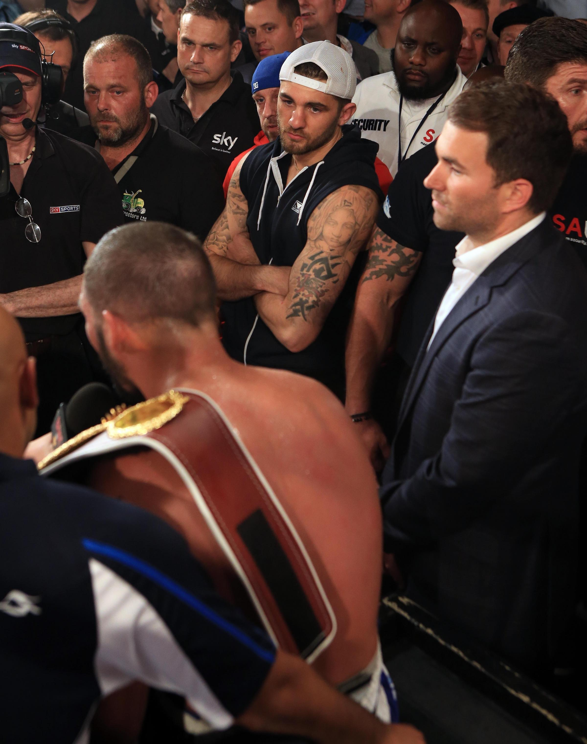 GRUDGE: Nathan Cleverly, centre, listens to Tony Bellew's taunts at the Echo Arena, Liverpool, on Saturday