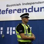 Campaign Series: A police officer stands in the Highland Hall at the Royal Highland Centre during the count for the Scottish Referendum