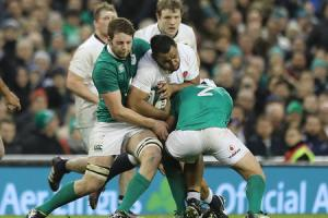 CLUB DUTY: Ireland's Iain Henderson, tackling England number eight Billy Vunipola, is available for Ulster