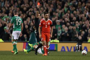 RED: Wales' Neil Taylor was sent off against Ireland in Dublin