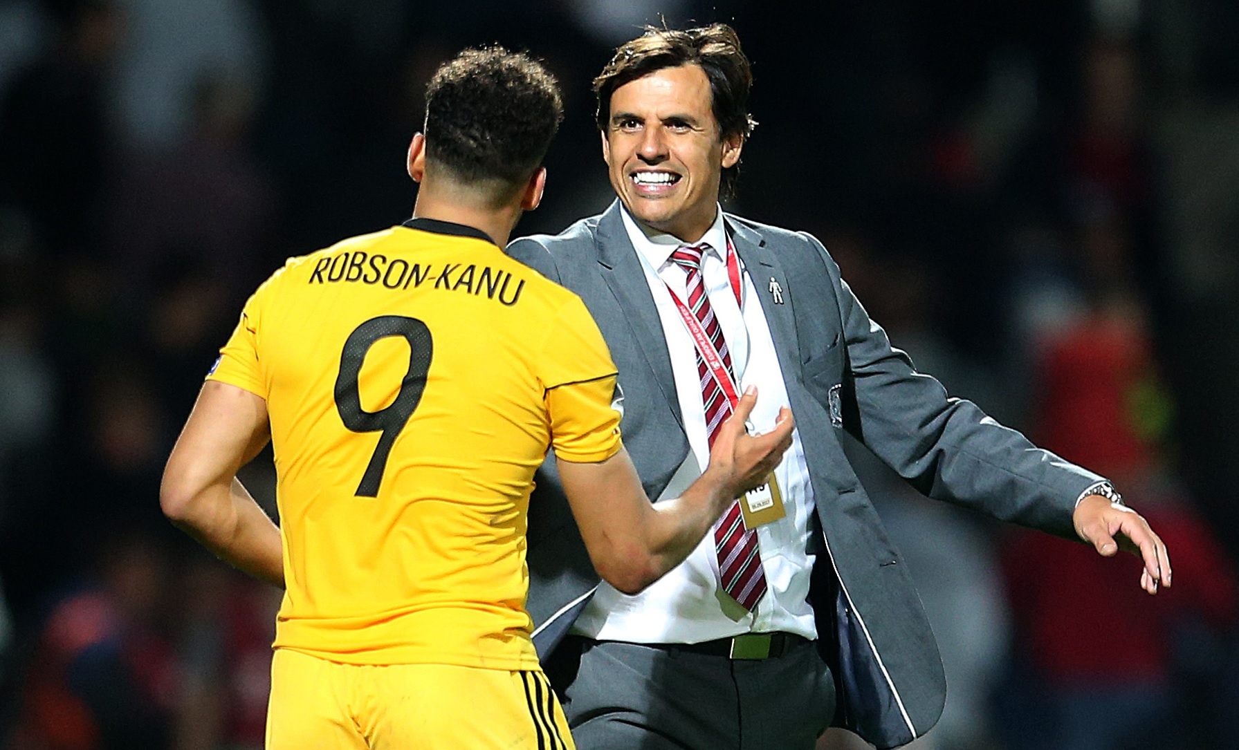 RELIEF: Wales boss Chris Coleman celebrates with scorer Hal Robson-Kanu in Moldova