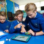 Campaign Series: (L-R) Isaac Willmore, Callum David Williams and Callie Jones coding with Lego to make a robot