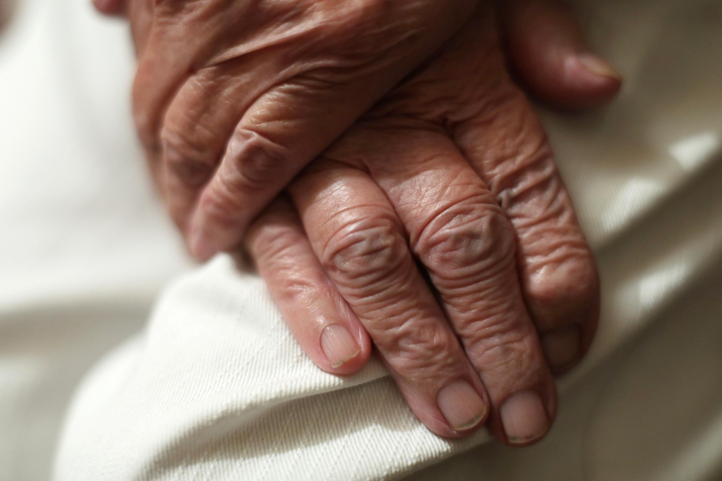 Embargoed to 0001 Friday December 1..File photo dated 22/12/16 of an elderly woman's hands. Almost one million older people feel lonelier at Christmas time, Age UK has found. PRESS ASSOCIATION Photo. Issue date: Friday December 1, 2017. Alongside new
