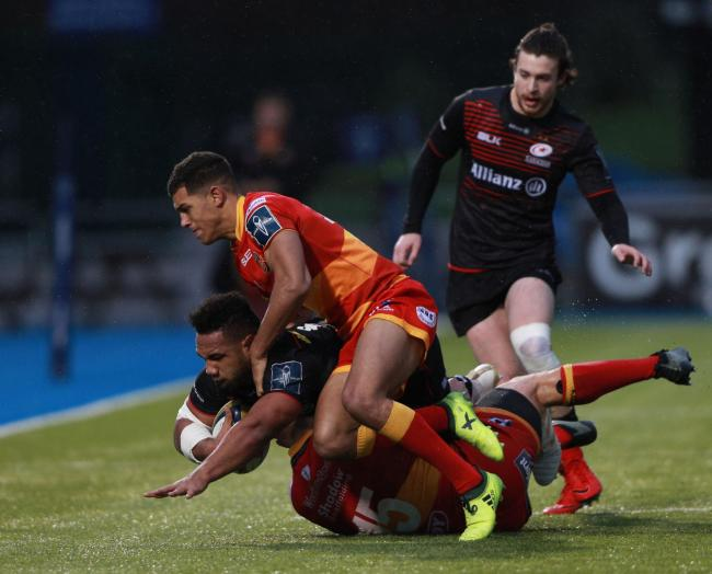 Sione Vailanu of Saracens is tackled by Sam Beard and Carl Meyer of Dragons during the Anglo-Welsh Cup, pool three match at Allianz Park, London. PRESS ASSOCIATION Photo. Picture date: Saturday January 27, 2018. See PA story RUGBYU Saracens. Photo credit