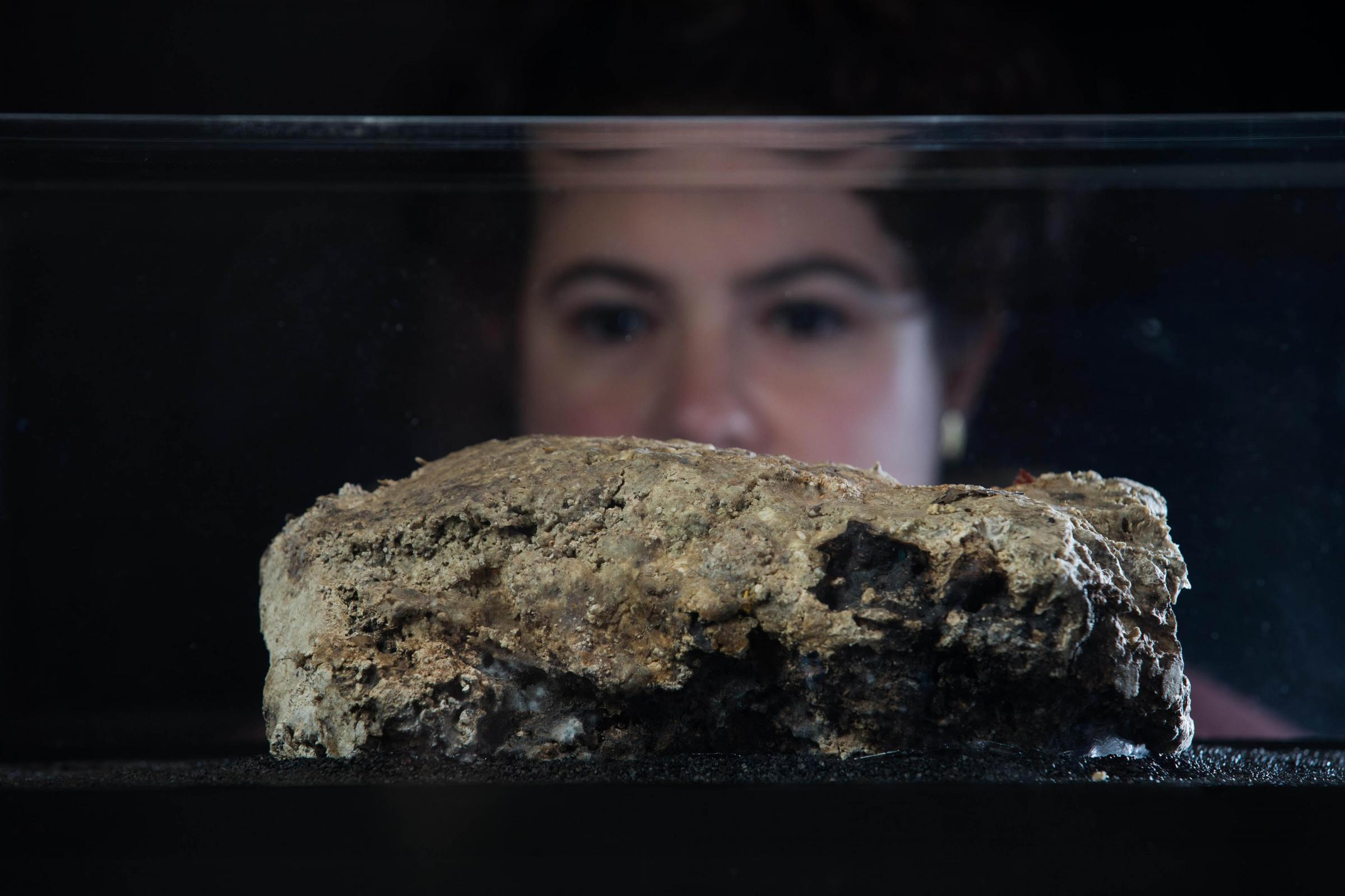 Katie Balcombe looks at a section of fatberg on display at the Museum of London (David Parry/PA)