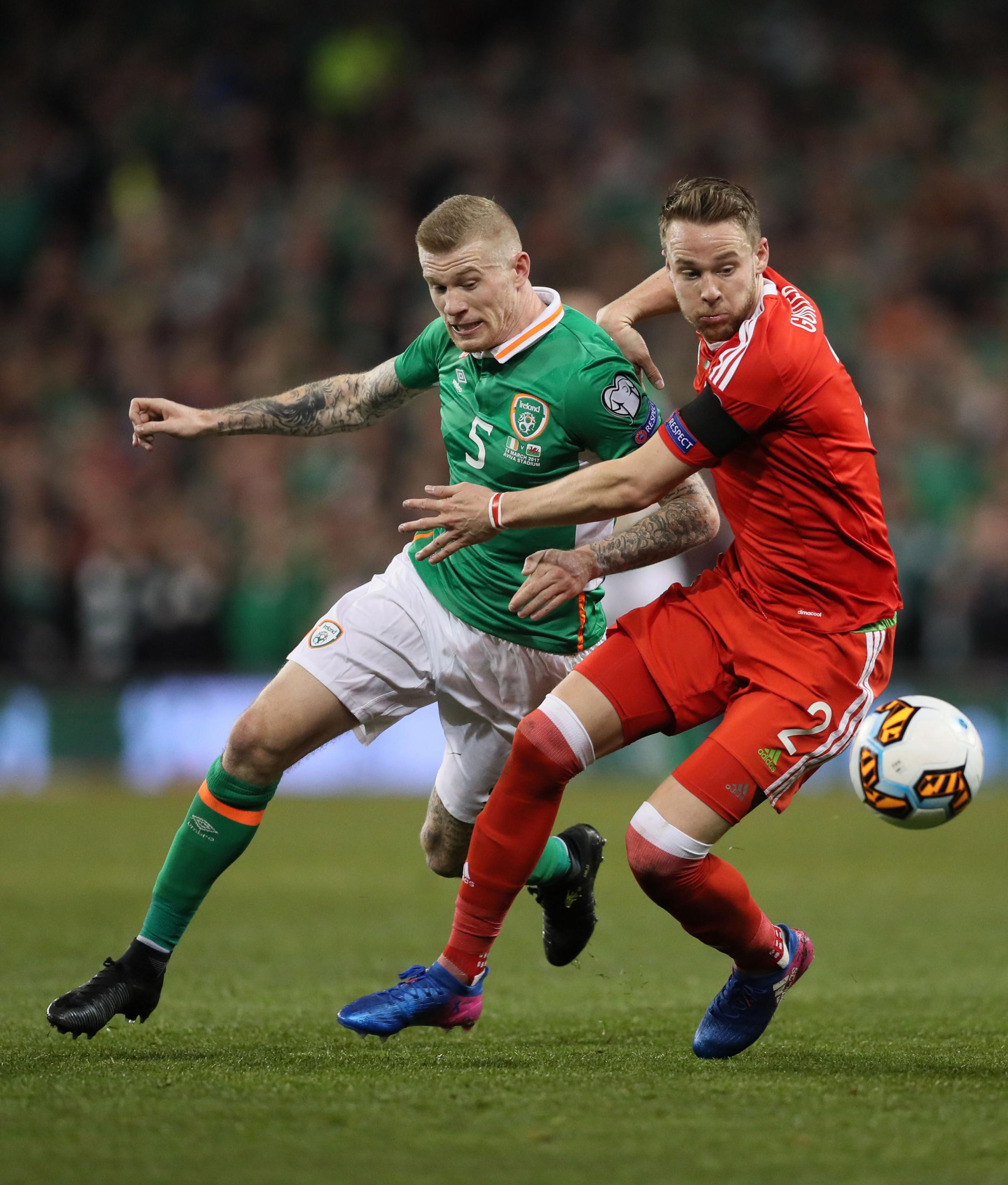 TOUGH TEST: Chris Gunter, right, in action against Ireland in a World Cup qualifier