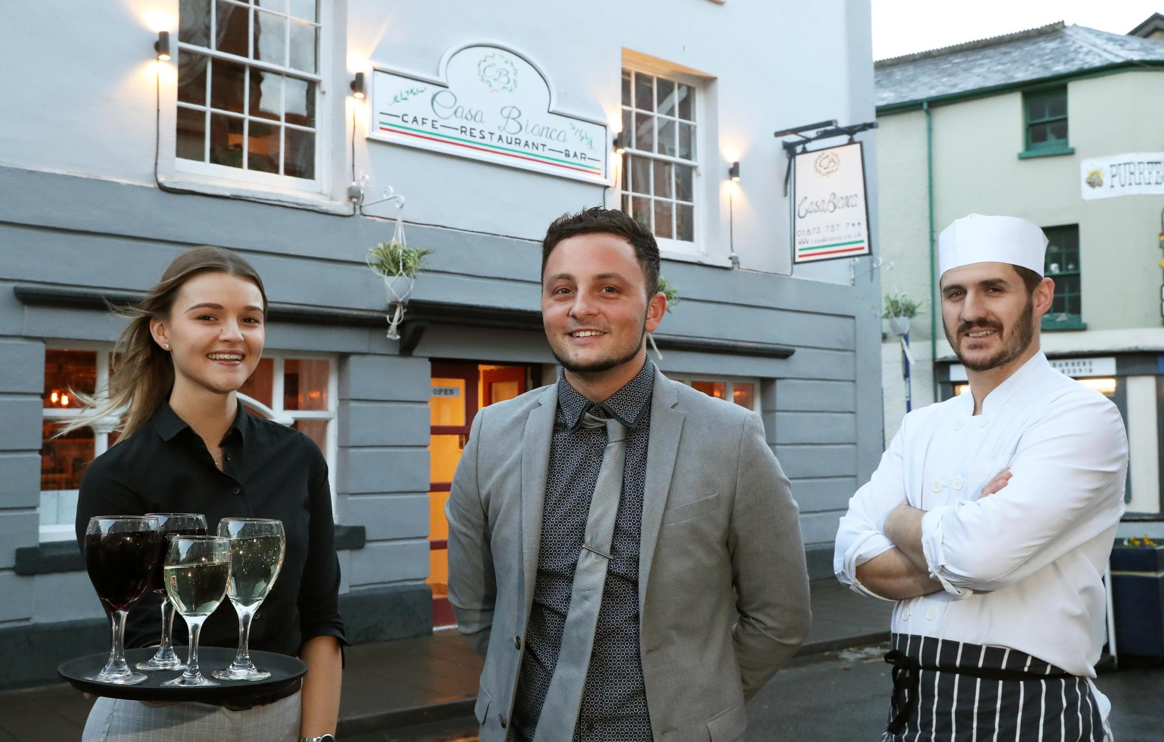 Staff outside the new restaurant left Ellie Carr, Andreas Christou, Alfred Leka