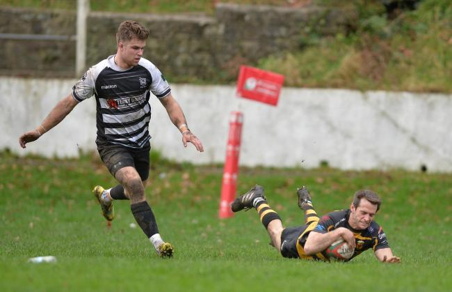 TRY TIME: Elliot Frewen crosses for Newport (Picture: Chris Tinsley Photography)