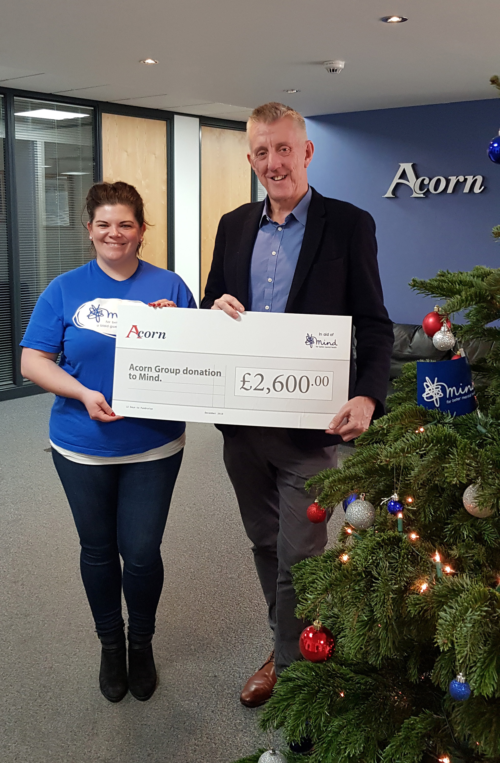 Andrew Tugwell presents Acorn's cheque to Mind