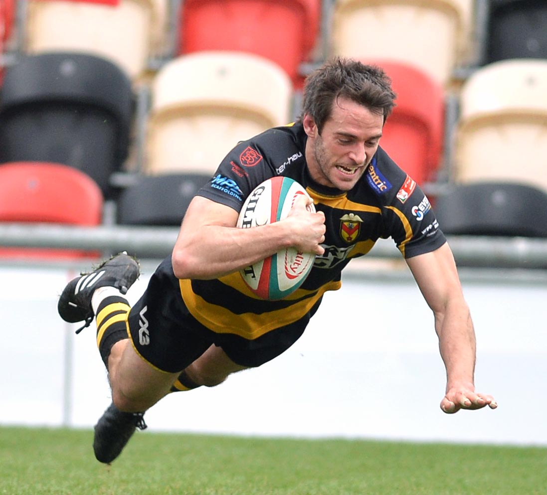 TOUCHDOWN: Elliot Frewen goes over for a Newport Try against Cardiff. Picture: christinsleyphotography.co.uk