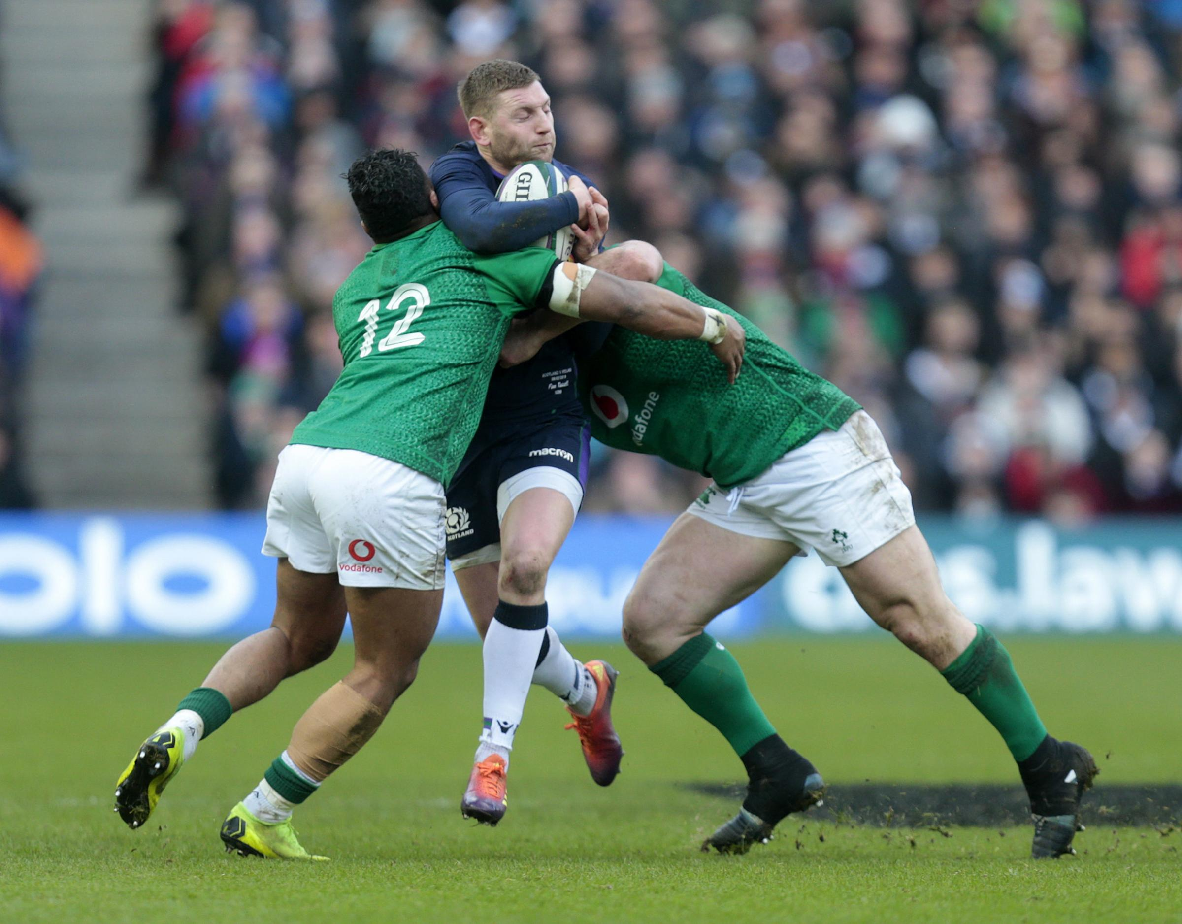 Scotland's Rhys Finn Russell (centre) vies with Ireland's Bundee Aki (left) and Cian Healy during the Guinness Six Nations match at BT Murrayfield, Edinburgh. PRESS ASSOCIATION Photo. Picture date: Saturday February 9, 2019. See PA story RUGBYU Sc