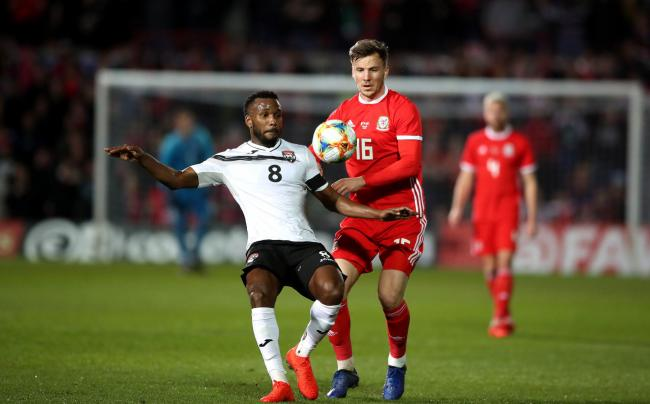 PRIDE: Newport's Lee Evans in action for Wales against Trinidad and Tobago on Wednesday