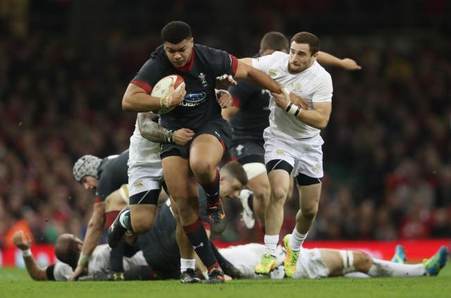 RUNNING HARD: Dragons prop Leon Brown on the charge for Wales against Tonga