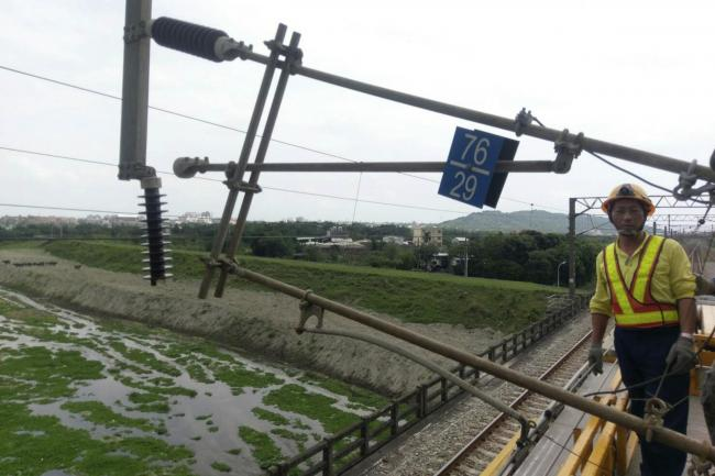 Railway workers inspect damaged facilities near Hualien