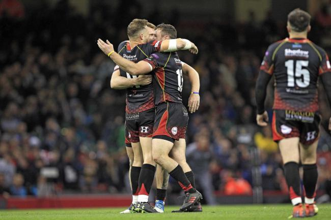 WINNING FEELING: The Dragons celebrate victory at Judgement Day