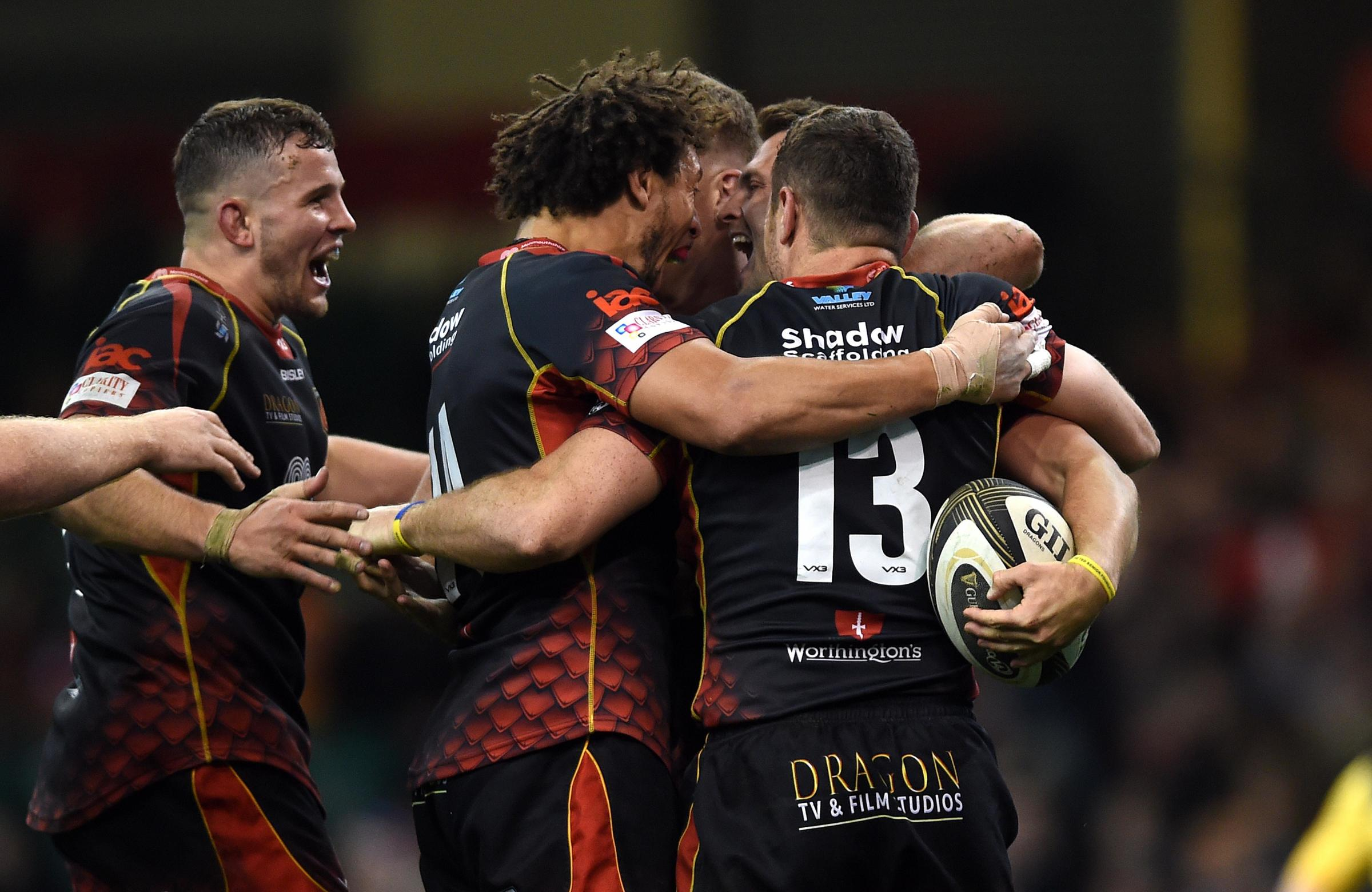 PURE JOY: The Dragons celebrate Josh Lewis' try in the win against the Scarlets
