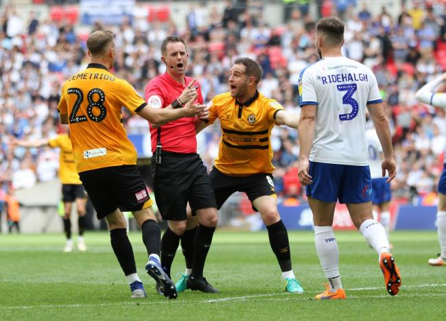 APPEALS: Newport County's Mickey Demetriou and Matty Dolan try to convince referee Ross Joyce to give a penalty at Wembley in May
